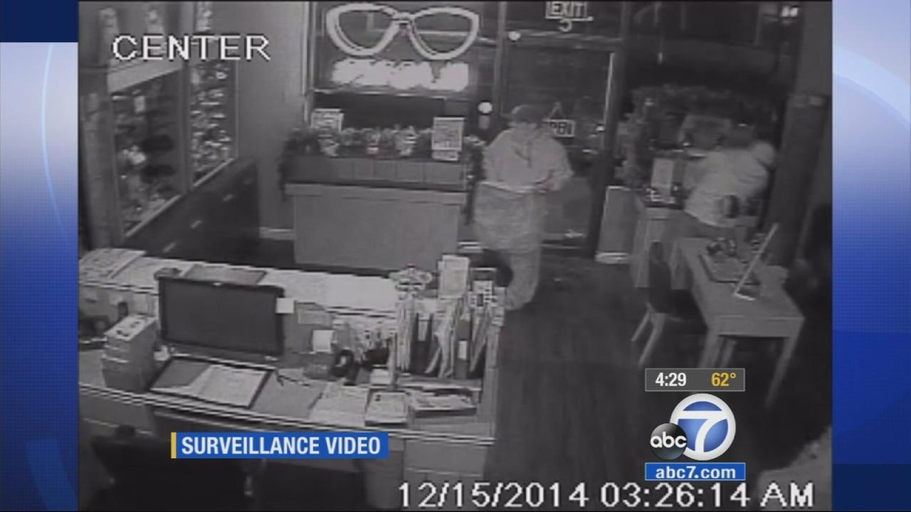 Surveillance video shows two suspects stealing thousands worth of frames from an Orange optometry office on Monday, Dec. 15, 2014.
