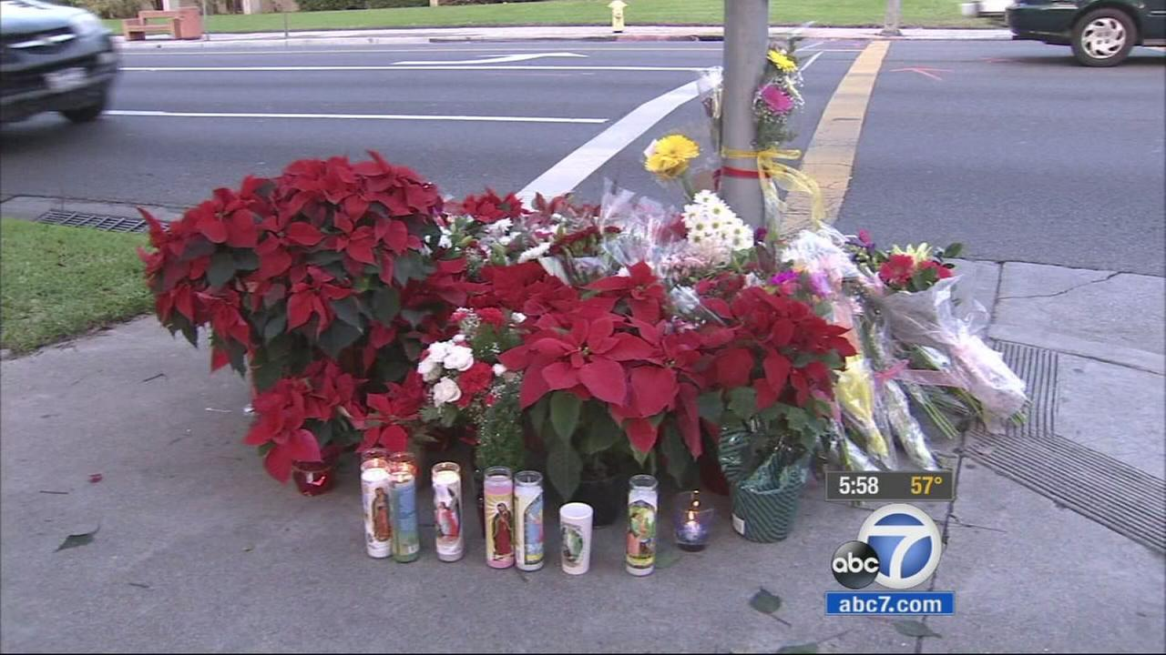 A makeshift memorial is seen outside a Redondo Beach church, where a group of pedestrians were struck by a driver on Wednesday, Dec. 17, 2014.