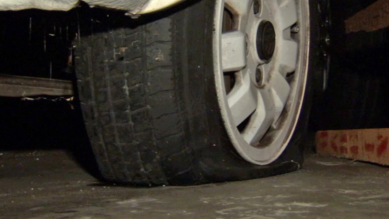 A tire is slashed in a Silver Lake neighborhood on Thursday, Dec. 18, 2014.