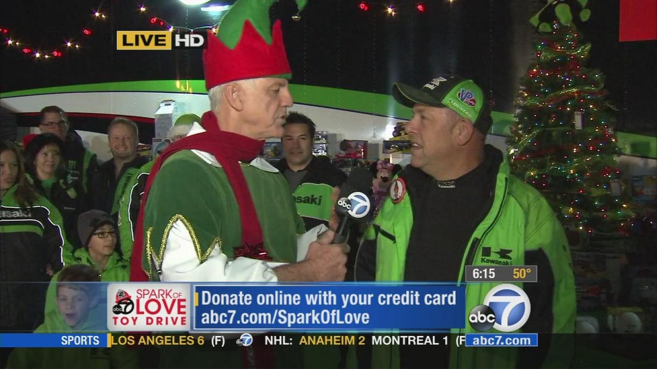 Kawasaki joined Garth the Elf at the Stuff-a-Bus event in Anaheim on Friday, Dec. 19, 2014.