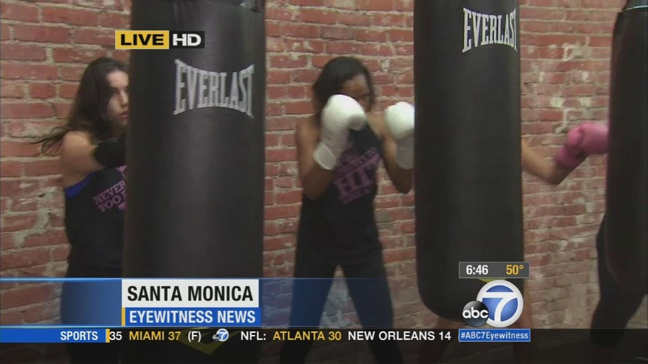 A group of women work with a punching bag at Prime Time Boxing in Santa Monica on Monday, Dec. 22, 2014.