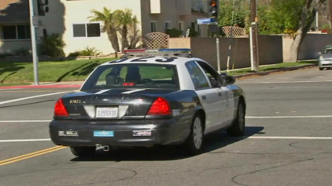 An LAPD police cruiser is seen.