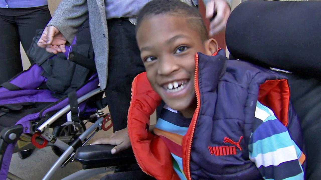 Arthur Day, 9, smiles after receiving a new wheelchair on Tuesday, Dec. 23, 2014.