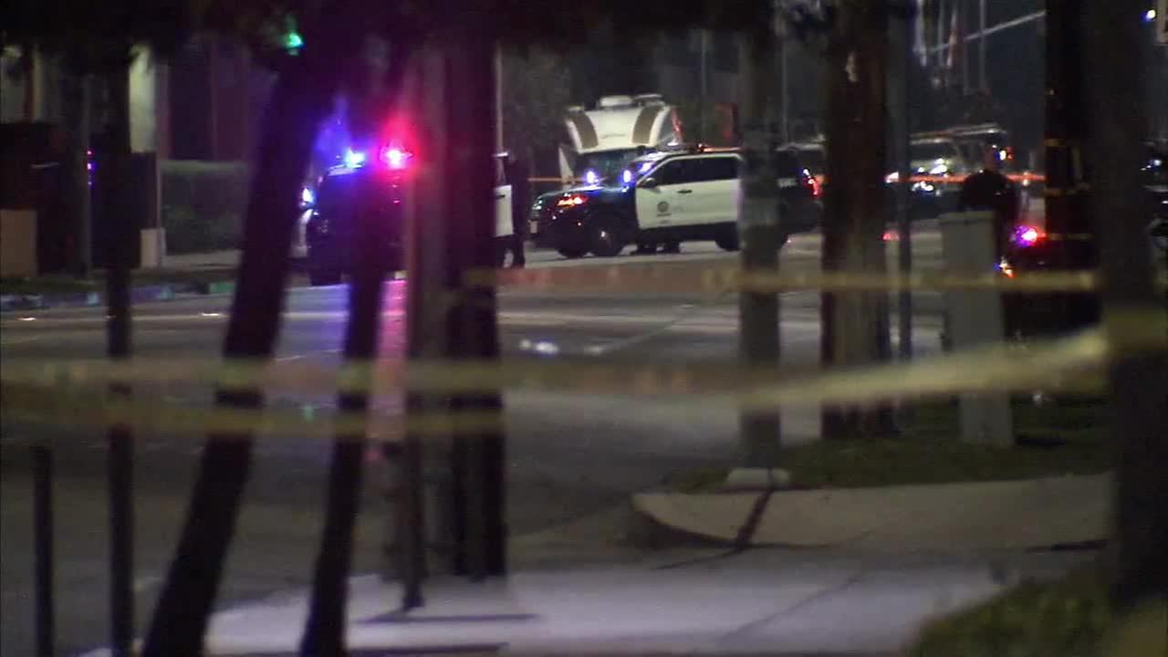 The LAPD set up a perimeter to search for a suspect who opened fire at a patrol car on Sunday, Dec. 28, 2014.