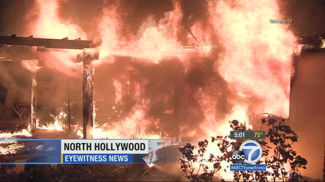 A fire erupts at a house in North Hollywood on Tuesday, Jan. 6, 2015.