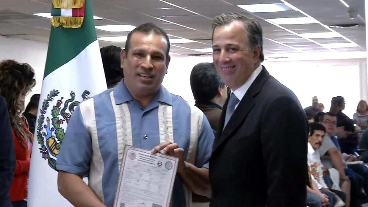 Pedro Zamora poses for a photo with Mexicos Secretary of Foreign Affairs Jose Antonio Meade after receiving his birth certificate on Thursday, Jan. 15, 2015.