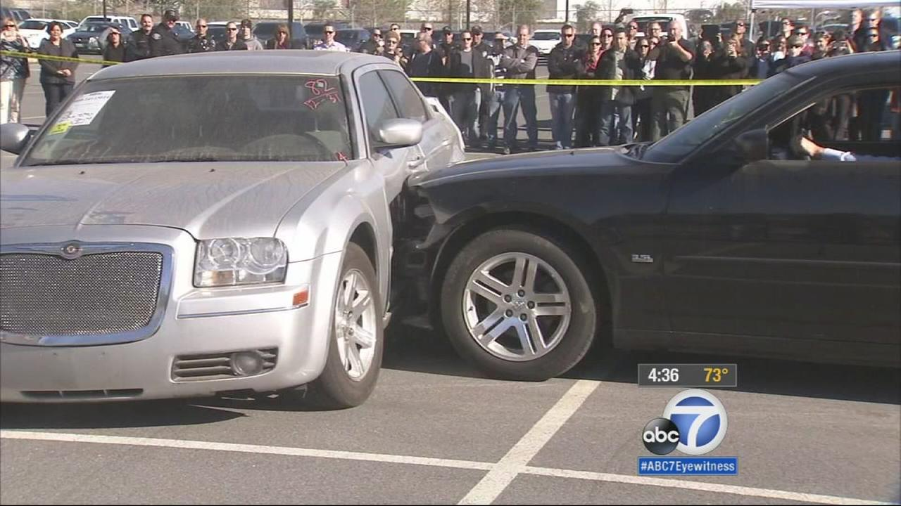 An insurance agency held a staged car crash event to help police identify signs of fraud Thursday.
