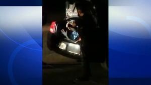 A man who locked himself in a strangers car trunk exits the vehicle in this undated file photo.