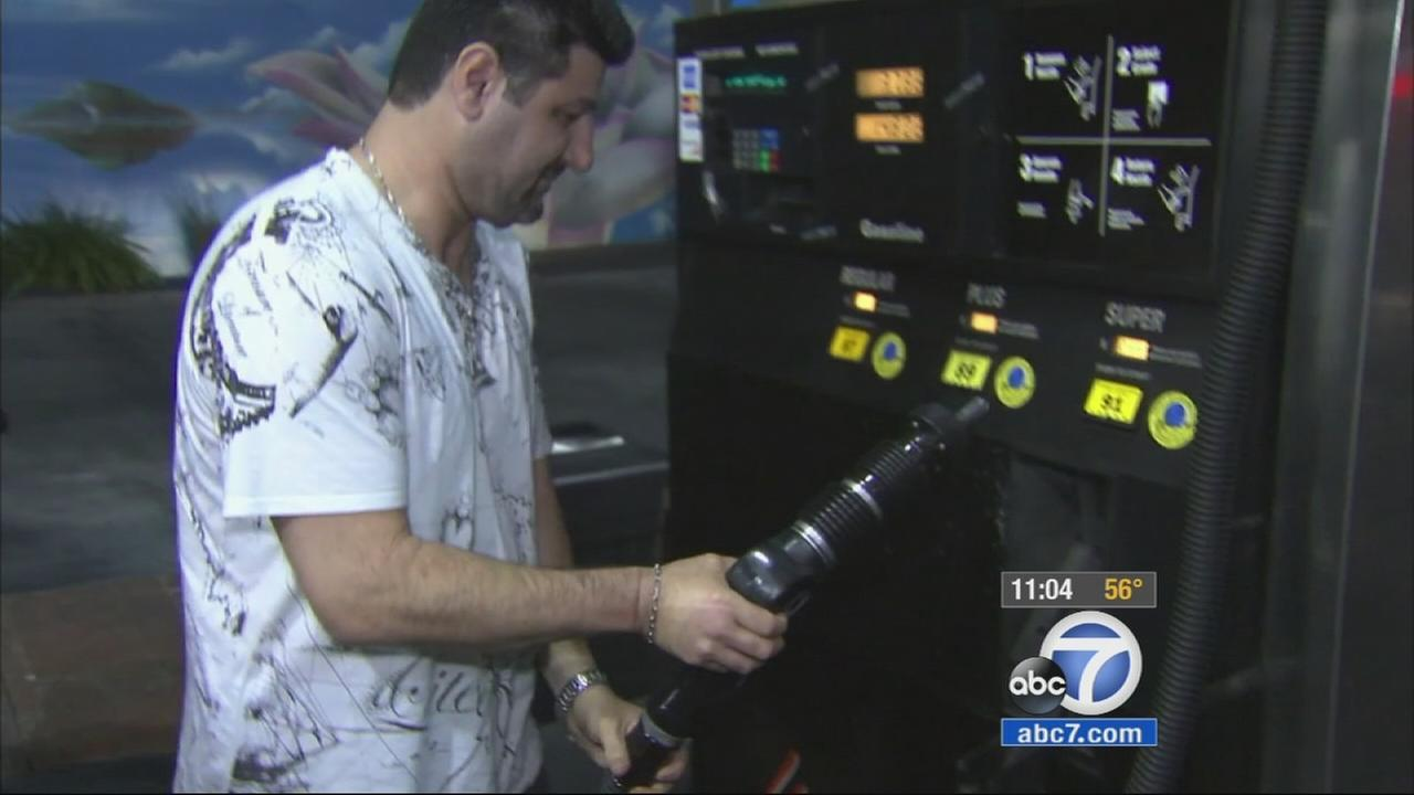 A man pumps gas in this undated photo.
