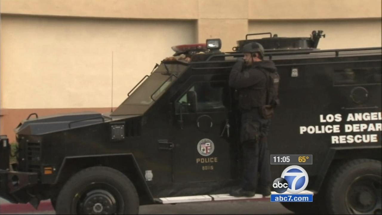 The LAPD searched for an armed suspect in the Chesterfield Square area of South Los Angeles Wednesday, Jan. 21, 2015.