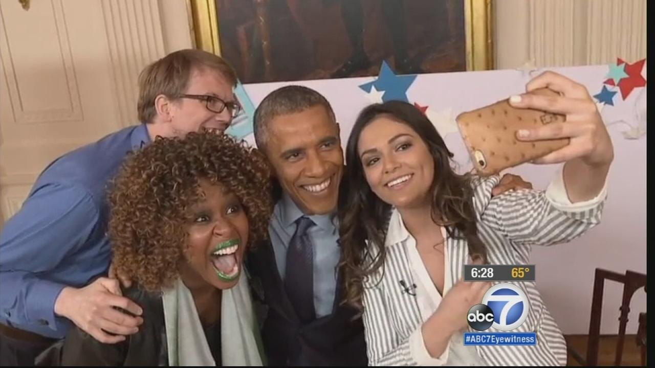 President Barack Obama takes a selfie with three YouTube stars, GloZell Green, Bethany Mota and Hank Green, after an interview.