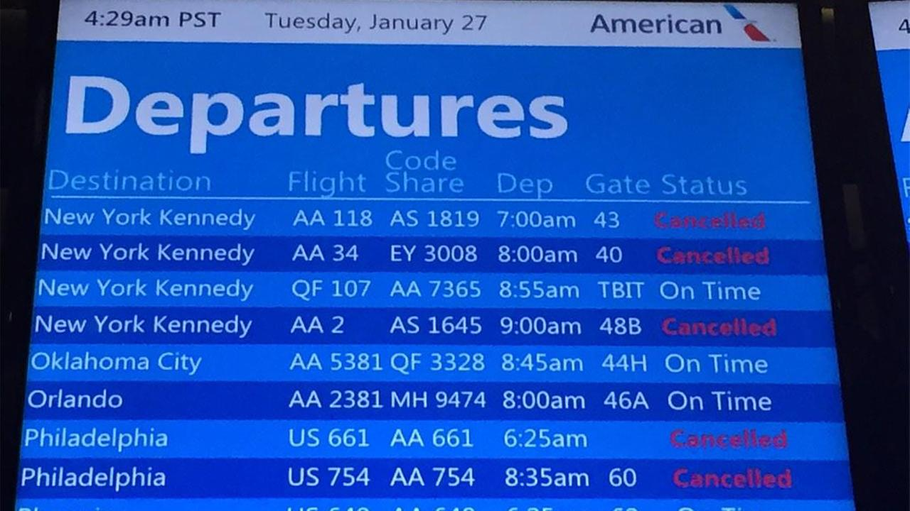 A sign at LAX shows canceled flights on Tuesday, Jan. 27, 2015.