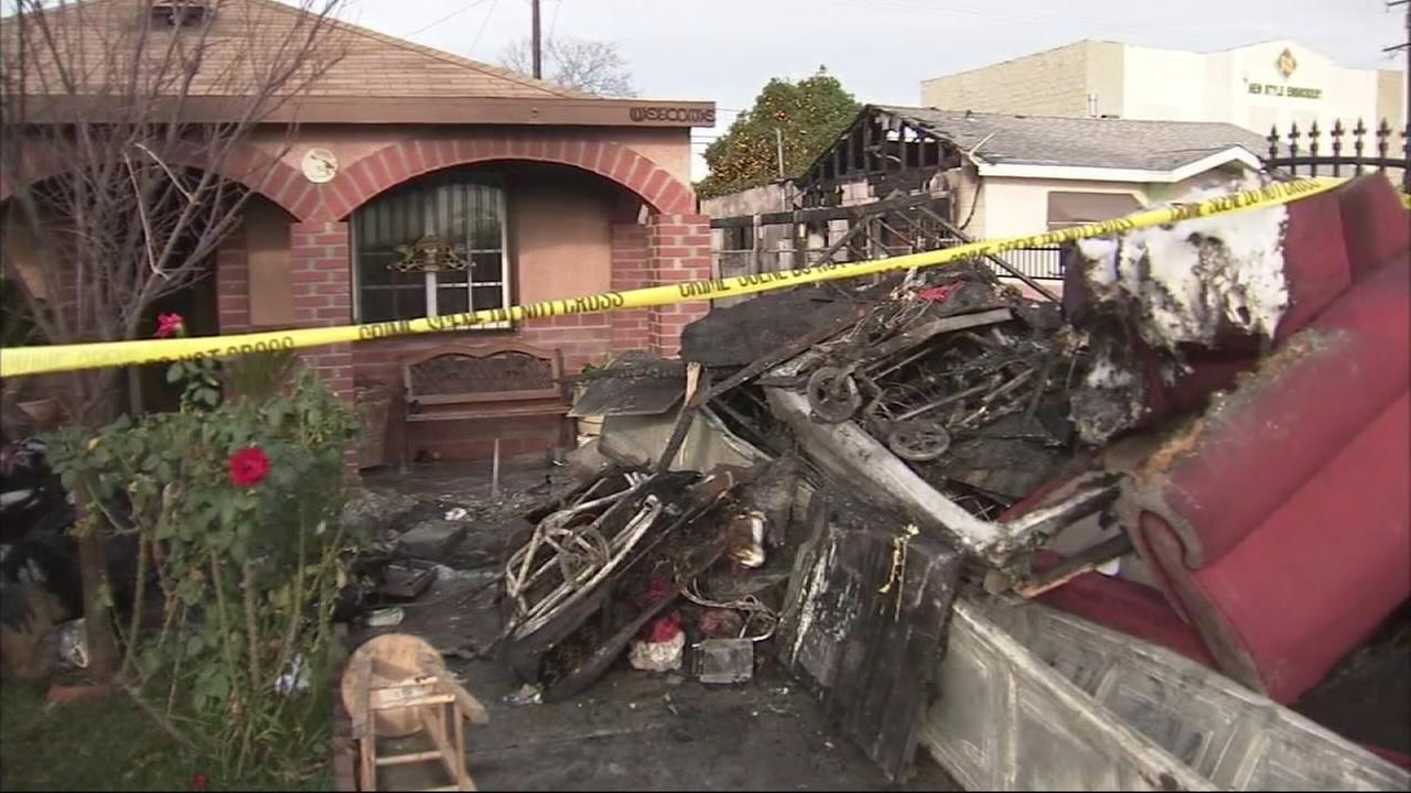 Charred furniture is seen following a fire at a home in El Monte on Wednesday, Jan. 28, 2015.