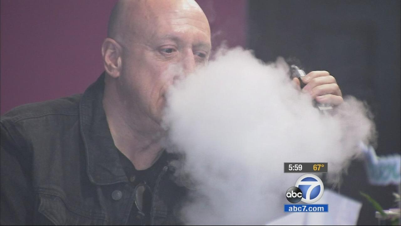 A man uses an e-cigarette at the Vapor Shop in Sherman Oaks on Wednesday, Jan. 28, 2015.