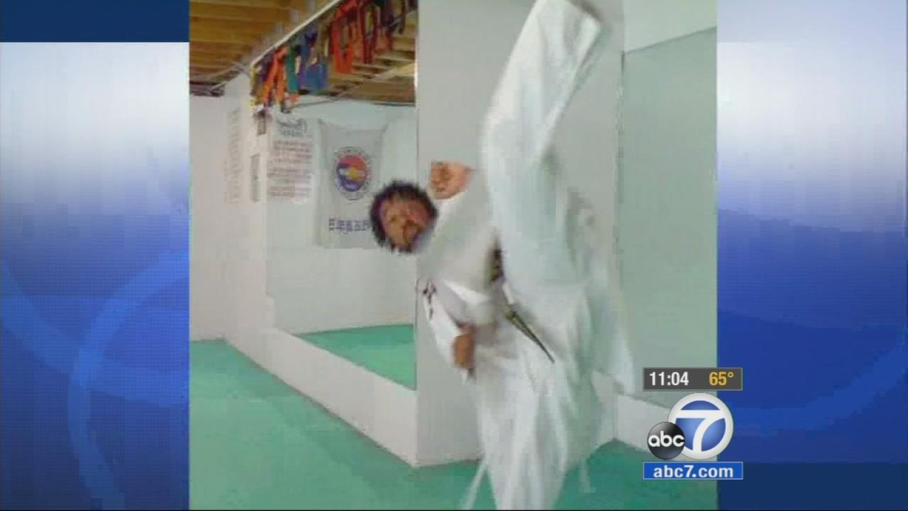Michael Robertson, 30, performs taekwondo in this undated file photo.