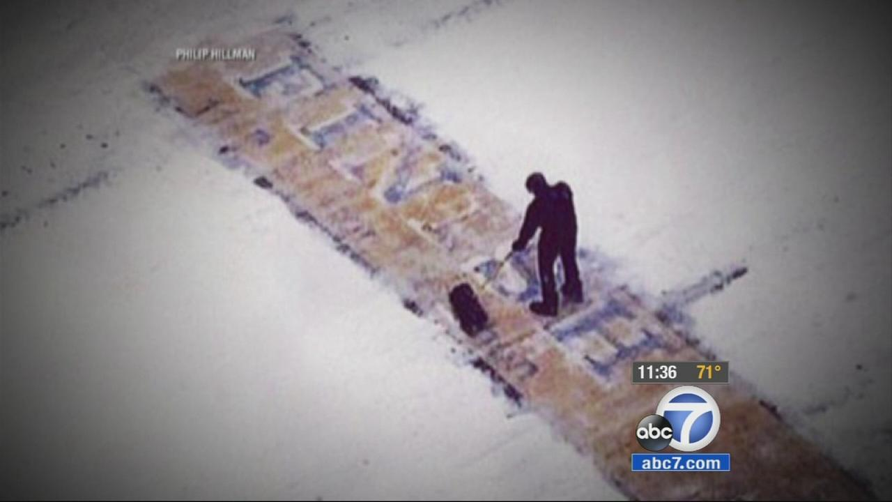 After an image of a man shoveling the finish line of the Boston Marathon during Tuesdays snow storm, the mystery of who he is has been solved.