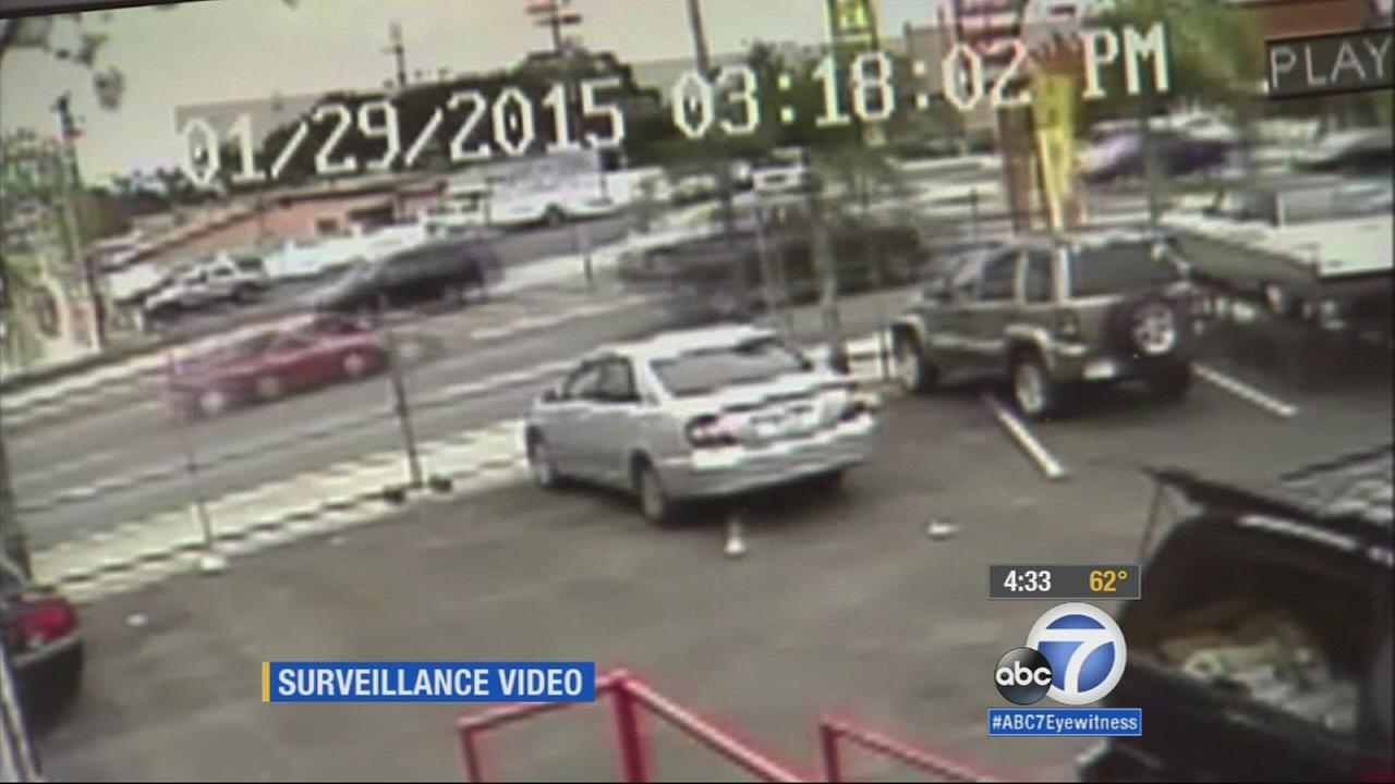 Surveillance video shows a red Honda and a dark- colored pickup truck speeding west in the eastbound lanes on PCH, just moments before the crash Jan. 29, 2015.