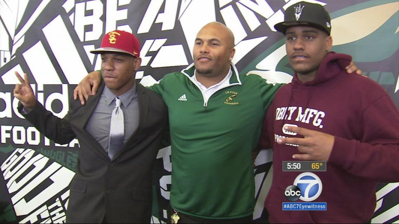 A Trojan recruit poses for a photo.