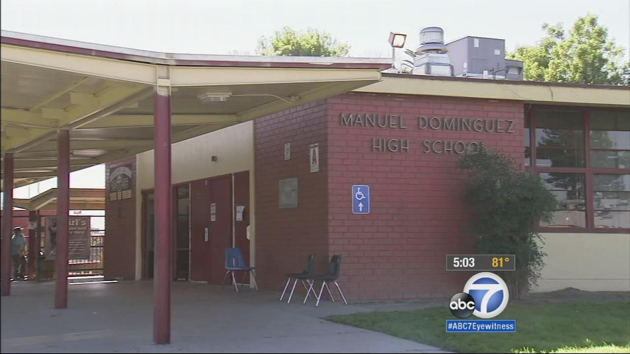 A Compton high school principal has been placed on administrative leave as authorities investigate reports that he inappropriately hand-searched students.