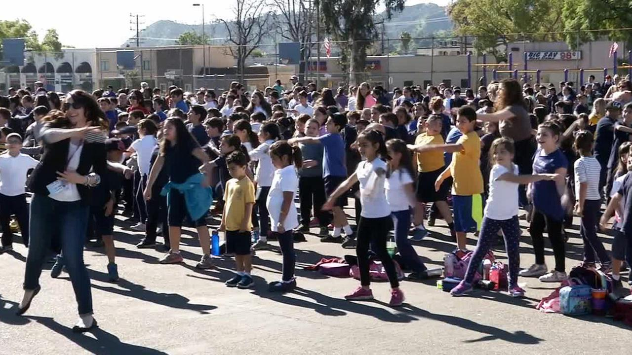 Students at Thomas Jefferson Elementary School in Glendale help try to set a world exercise record on Thursday, Feb. 12, 2015.