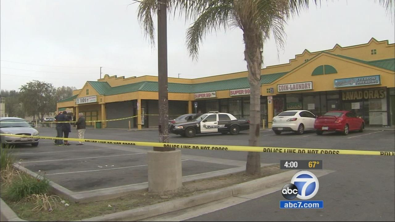 A search is underway for two suspects after a security guard was shot and killed at an illegal marijuana dispensary in San Bernardino.