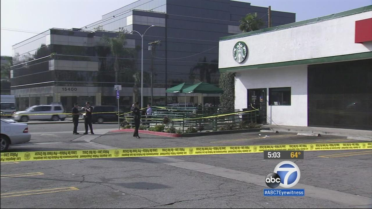A man is in critical condition after setting himself on fire in a Starbucks bathroom in Van Nuys on Tuesday.