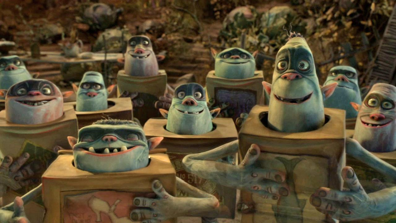 A group of Boxtrolls gather around and smile in one of five Oscar nominated movies, The Boxtrolls.