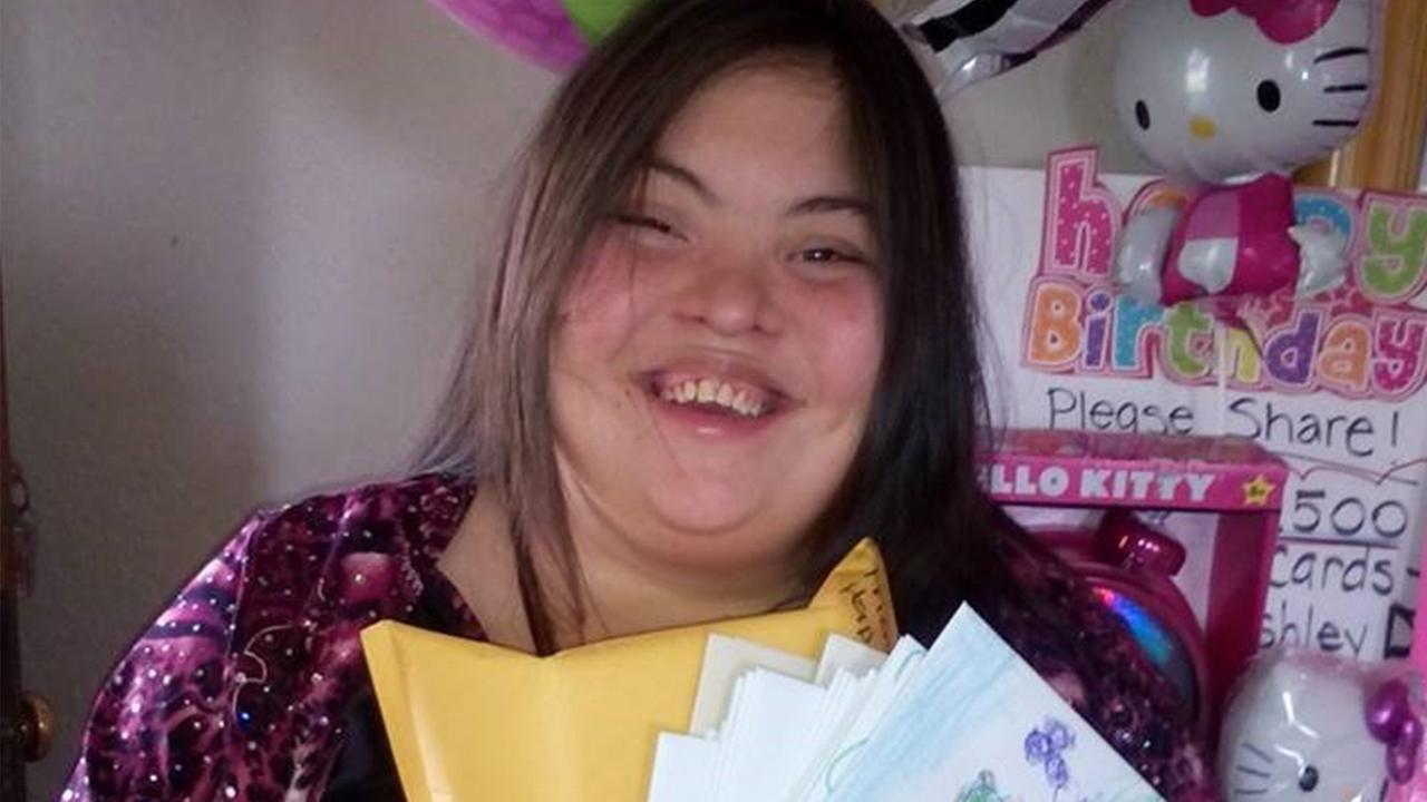 Ashley Diaz holds up a handful of birthday cards she received for her 25th birthday.
