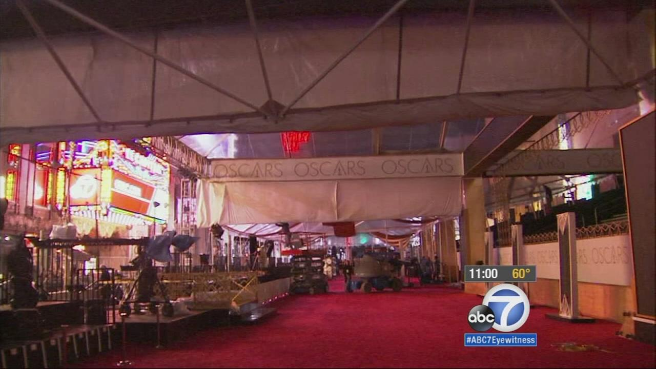 Rain canopies are put up in anticipation of wet weather during the 2015 Oscars.