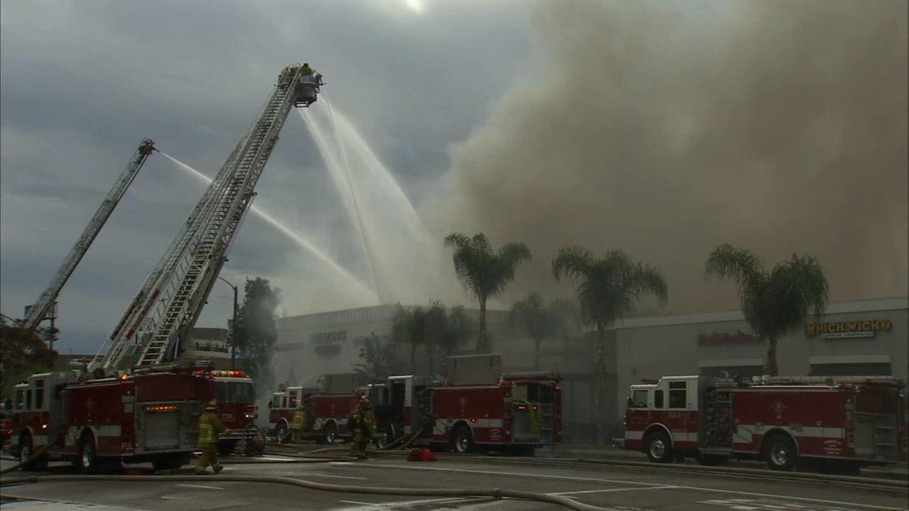 A massive fire erupted at Dillons Bar and Grill in Fullerton Sunday, March 1, 2015.