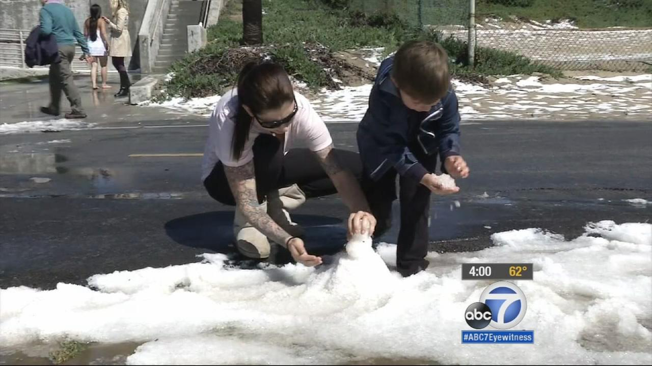 A fast-moving storm turned Southern California beach cities like Huntington Beach and Long Beach white from hail.