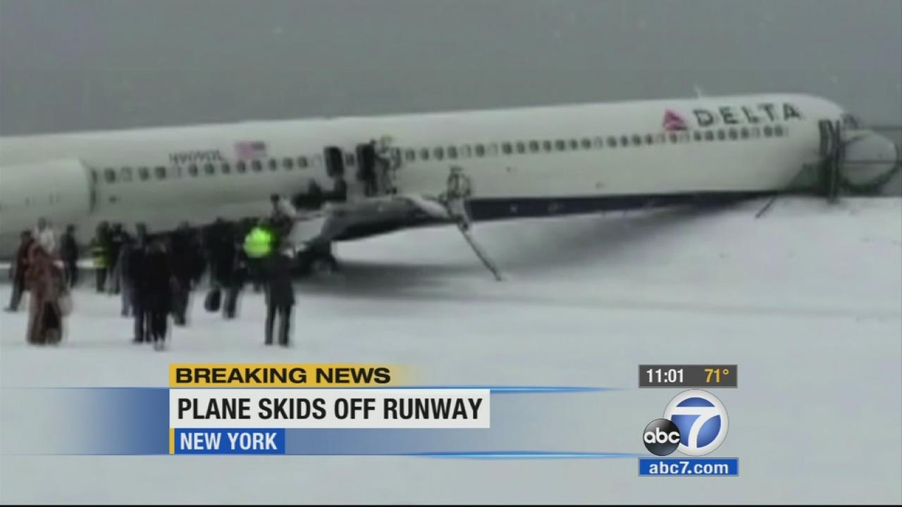 A plane skidded off a runway while landing at New Yorks LaGuardia Airport on Thursday, crashing into a fence.