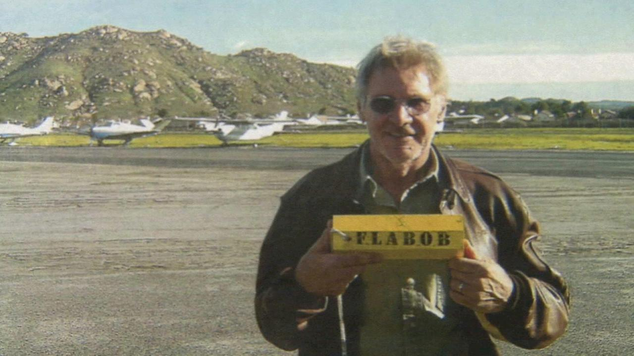 Harrison Ford holds a Flabob Airport sign in this undated file photo.
