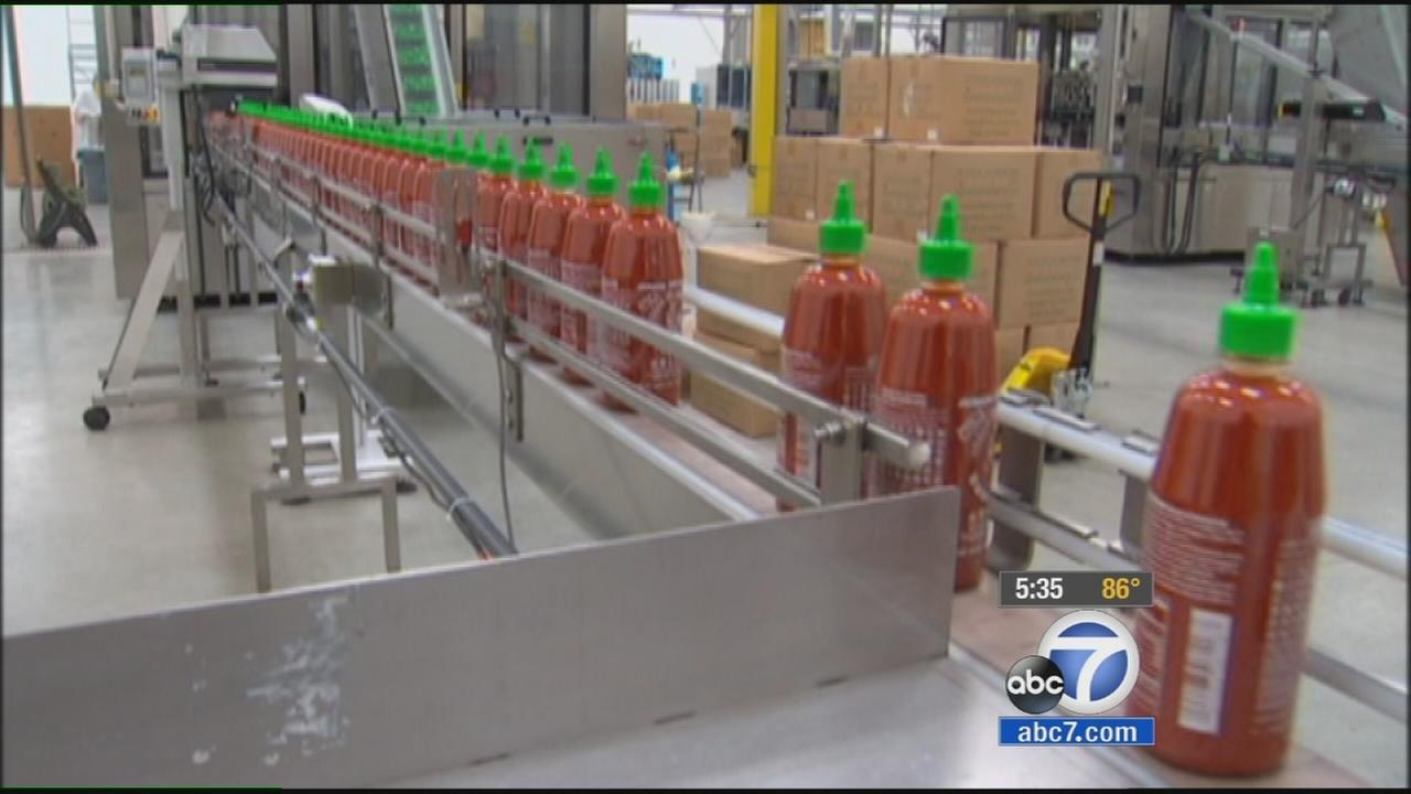 Sriracha bottles are seen at the hot sauce factory in Irwindale in this undated file photo.