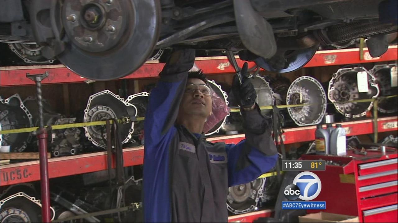 Hung Nguyen fixes a car at an auto repair shop in South El Monte on Monday, March 16, 2015.