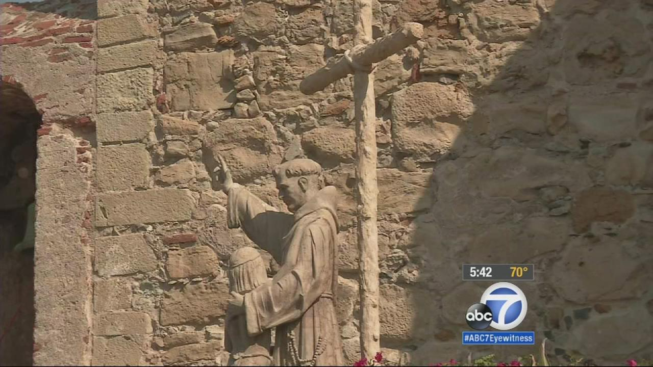 A statue of Father Junipero Serra stands at Mission San Juan Capistrano.