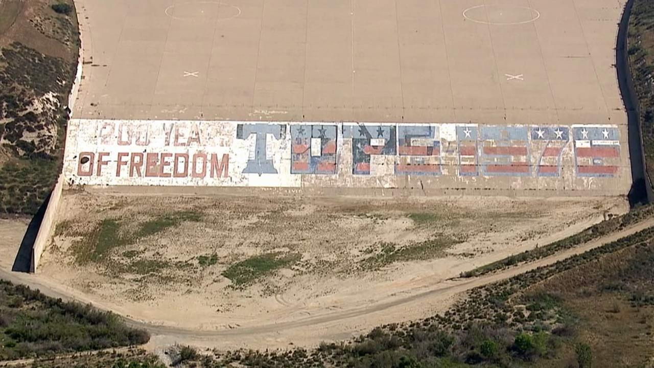A patriotic mural is being removed as part of a modernization project on the Prado Dam.