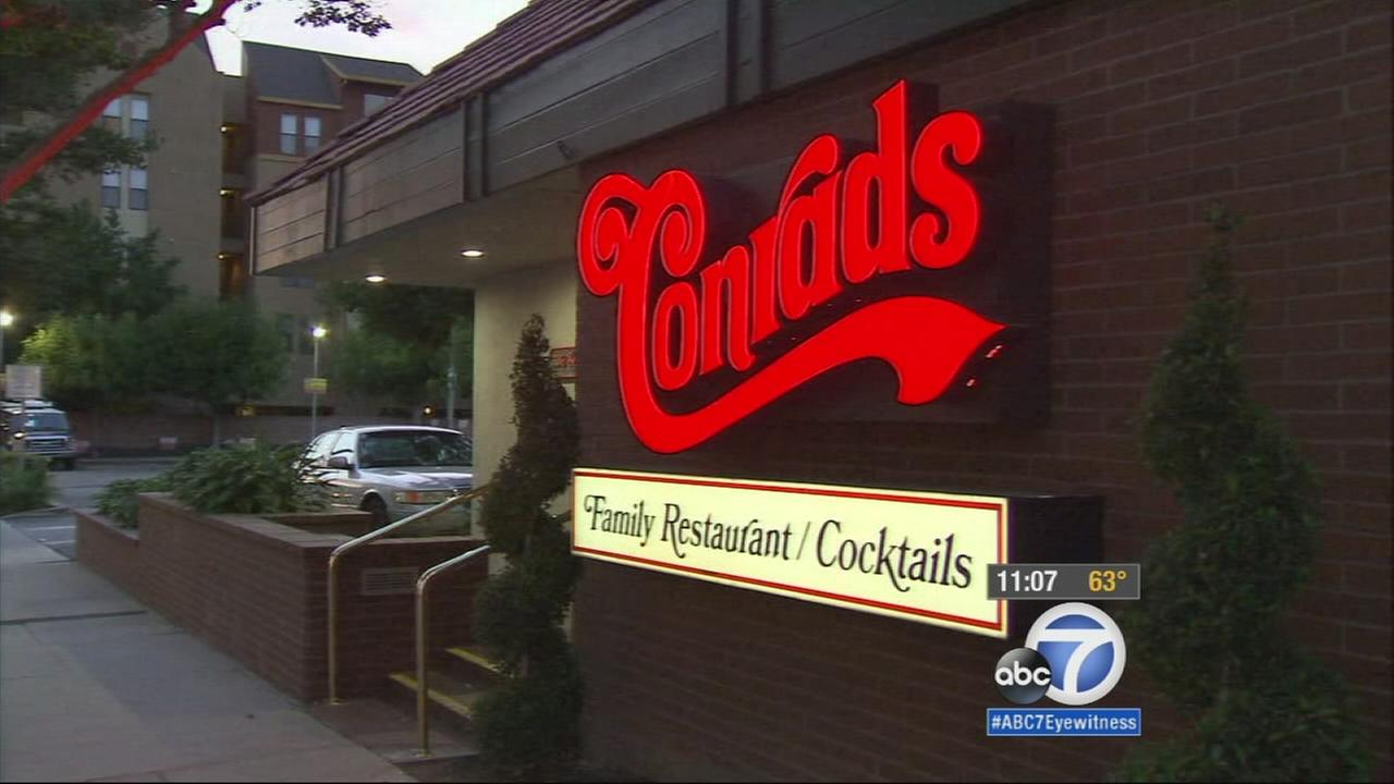 A customer at a Pasadena restaurant said she invited a homeless man to eat with her and her son, but the man was then told to take his food to go by the owner.