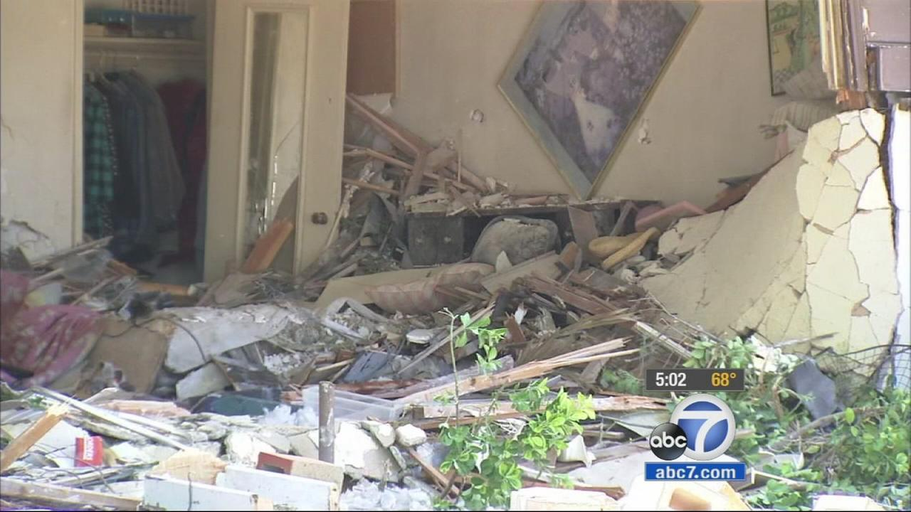 A Lancaster home is in shambles after a suspected drunk driver slammed a truck into the building, killing a woman in her 70s, on Sunday, March 29, 2015.