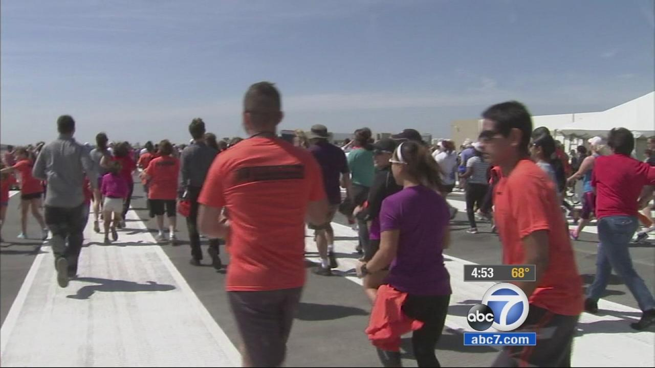 Hundreds of people got the rare chance to Run The Runway at Long Beach Airport to celebrate the new $15 million runway renovation.