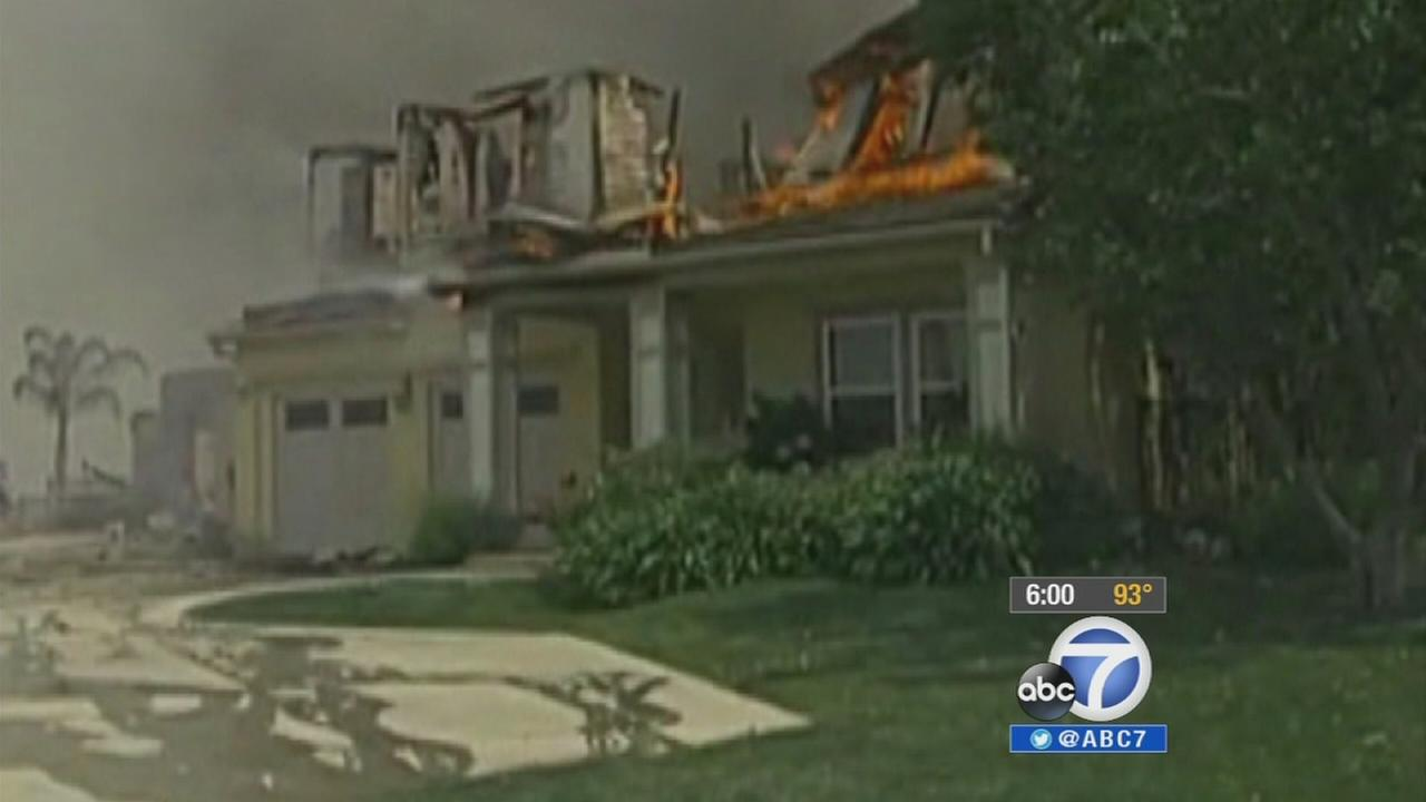A home burns in Carlsbad in San Diego County on Wednesday, May 14, 2014.