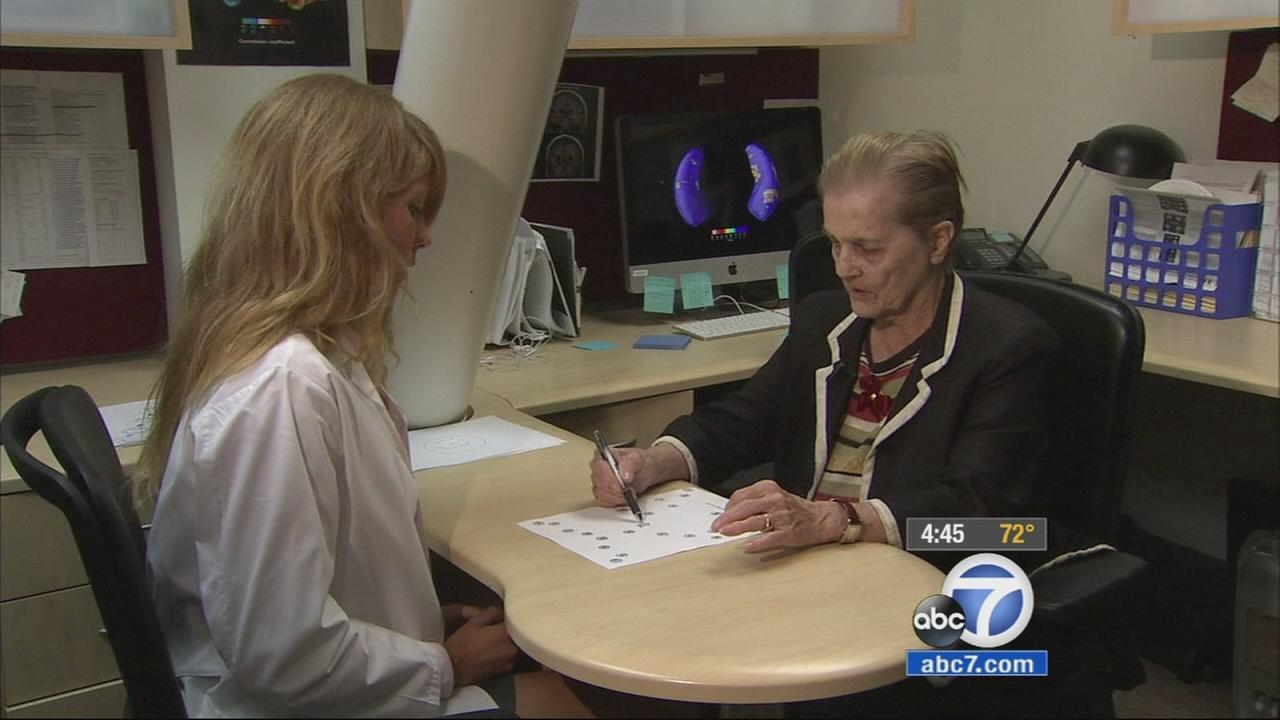 Joyce Ralston tries to complete an Alzheimers test in this undated file photo.