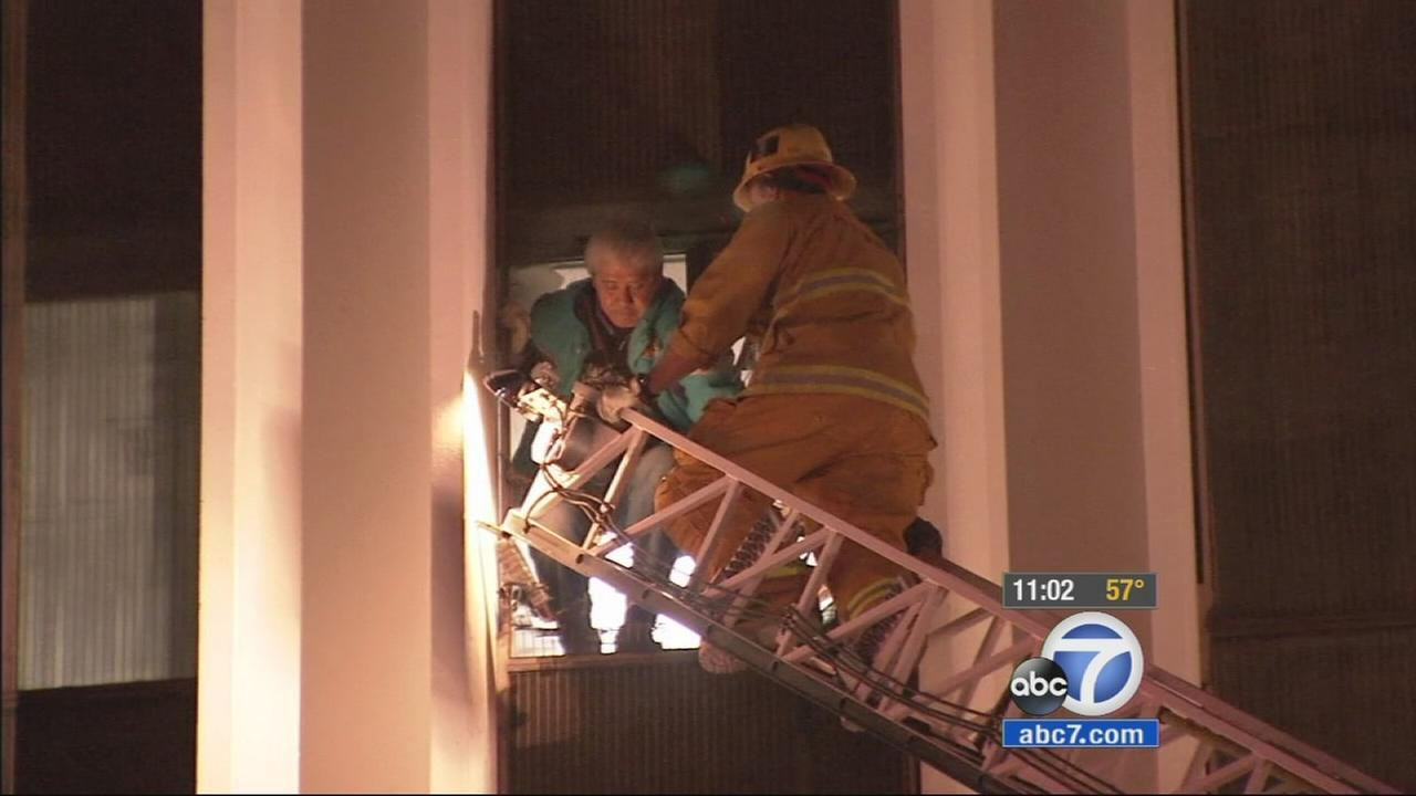 Los Angeles firefighters rescued two people from a building fire in the 1500 block of W. Olympic Boulevard Tuesday night.