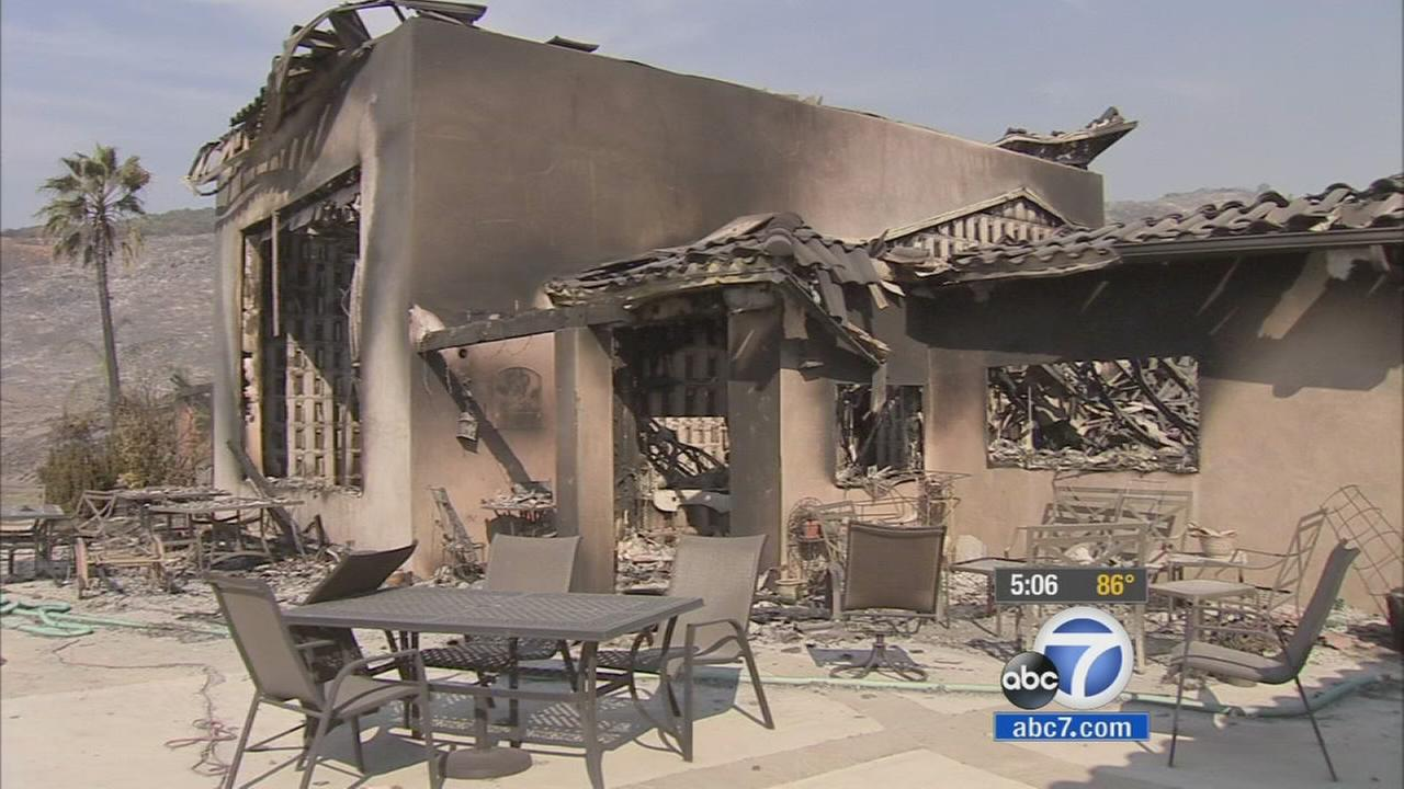 A home was destroyed as wildfires swept through San Diego County.