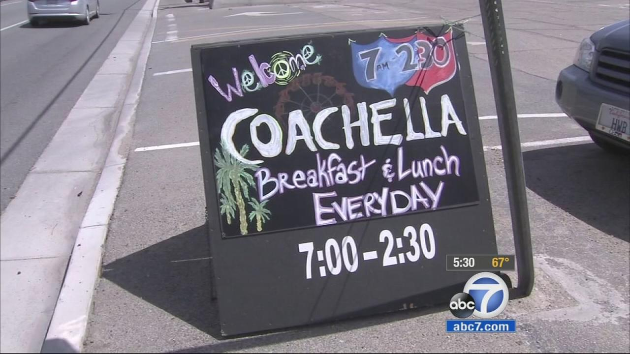 A sign for a restaurant welcomes Coachella attendees on Friday, April 10, 2015.