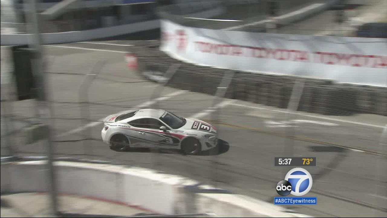 A car races through the Toyota Grand Prix of Long Beach on Friday, April 17, 2015.