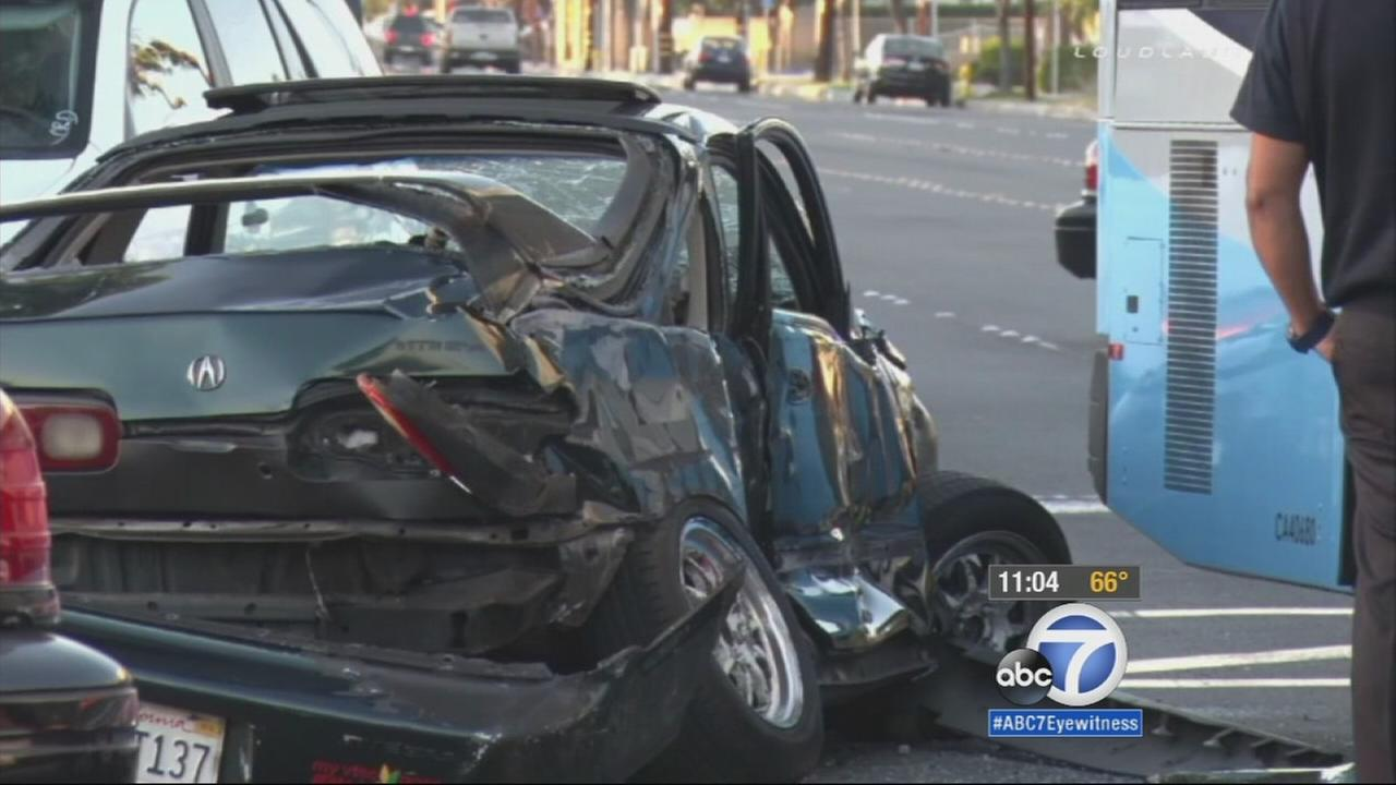 An Acura Integra that slammed into a Norwalk transit bus in Bellflower is totaled on Friday, April 17, 2015.