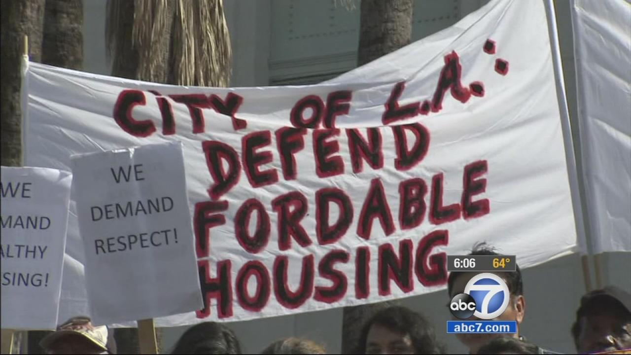 Affordable housing protesters rally in front of City Hall to demand reforms on Wednesday, April 22, 2015.