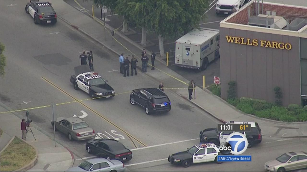 Inglewood police investigate an armored truck robbery outside a Wells Fargo on Friday, April 24, 2015.