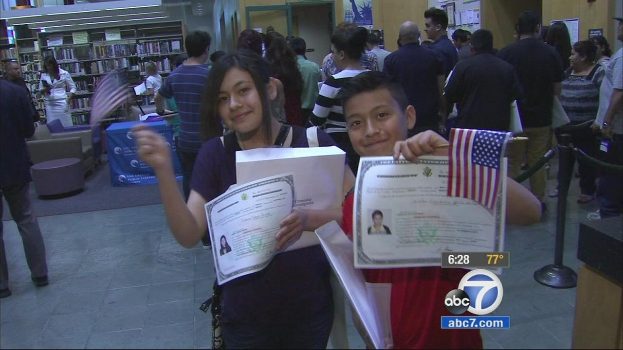 Two children took an oath of allegiance to become U.S. citizens in North Hills, Los Angeles on Tuesday, April 28, 2015.